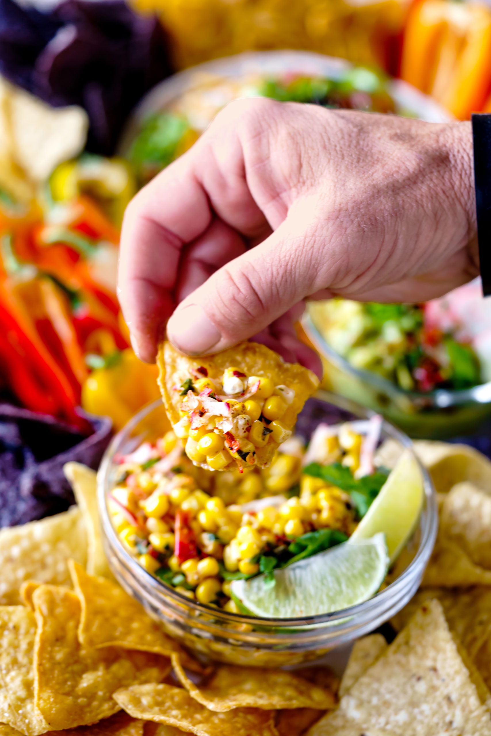 Mexican Corn Dip served with chips and crispy vegetables.